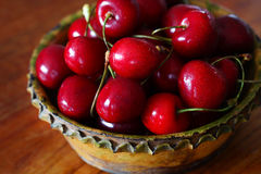 Cherries in a rustic bowl Stock Photo
