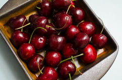 Cherries in a rustic ceramic bowl Royalty Free Stock Photos