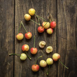 Cherries on a rustic  table Stock Images