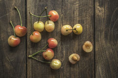Cherries on a rustic  table Royalty Free Stock Photos