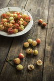 Cherries on a rustic  table Royalty Free Stock Image