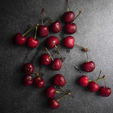 Cherries on a rustic  table Stock Image