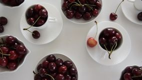 Top view of raw cherries in white cups and bowls. Cherries season. Top view of raw cherries in white cups and bowls stock video footage