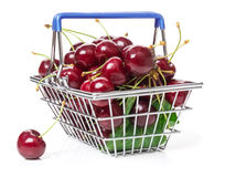 Cherries in shopping basket Royalty Free Stock Image