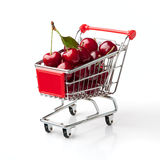 Cherries in Shopping Cart. Shopping Cart Isolated On White Background Royalty Free Stock Photos