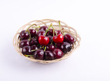 Cherries in a small basket Royalty Free Stock Image