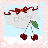 Cherries in the Snow with frame Stock Photo