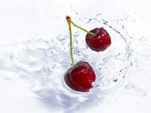 Cherries splashing Royalty Free Stock Images