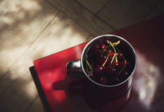 Cherries in a steel cup Stock Photography