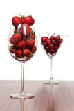 Cherries & strawberries. A glasses full of fruits Stock Image
