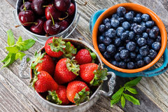 Cherries, Strawberries, and Blueberries in a Bowls Stock Photos