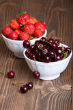 Cherries and strawberries in bowls Royalty Free Stock Images