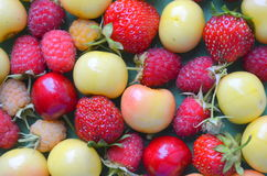 Cherries, strawberries, raspberries Stock Images