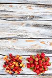 Cherries and strawberries on wood, top view. Heap of fresh summer berries and copy space. Healthy food and diet royalty free stock image