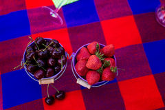 Cherries and strawberry in a bucket. Picnic at bachelorette part Royalty Free Stock Photo