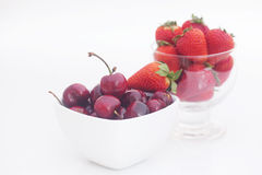 Cherries and strawberry in a ceramic and glass bowl Royalty Free Stock Photography
