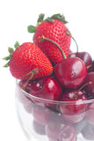 Cherries and strawberry in a glass bowl Stock Photography