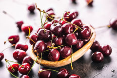 Cherries. Sweet Cherries. Fresh Cherries. Ripe cherries on wooden concrete table - board Stock Photos