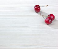 Cherries on the table. There are three cherries on the table Stock Photo