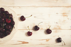 Cherries on a table. Muted colors. Royalty Free Stock Photography