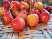 Cherries on table. Cherries on wicker table close up Royalty Free Stock Photos