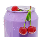 Cherries and tin Stock Photo