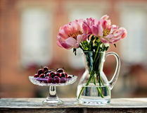 Cherries and Tulips Stock Photography