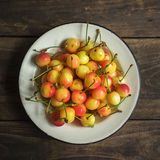Cherries in a vintage plate Royalty Free Stock Photo