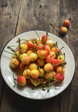 Cherries in a vintage plate Stock Photos