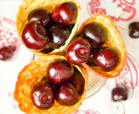 Cherries in a waffle cornet. Nice shine cherry in a waffle cornet Stock Photos