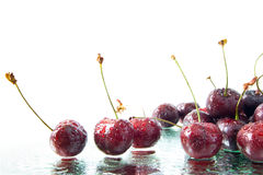 Cherries on water Stock Photos