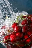 Cherries in water. Cherries in splash water with bubbles Stock Photos
