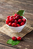 Cherries with water drops in the bowl stock photo