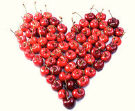 Cherries on white background - heart shape Royalty Free Stock Photo