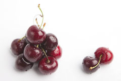 Cherries on white background. Isolated, dark red with drops of water Royalty Free Stock Photos