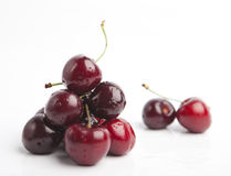 Cherries on white background. Isolated, dark red with drops of water Stock Photo