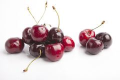 Cherries on white background. Isolated, dark red with drops of water Stock Photos