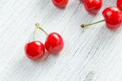 Cherries on a white background. Red berries with green twigs. Stock Photography