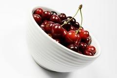 Cherries on white bowl Stock Photo