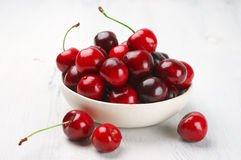 Cherries in white bowl Stock Image