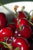 Cherries on a white cup Royalty Free Stock Photography