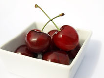 Cherries in white dish Royalty Free Stock Photography