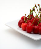 Cherries on the white plate Stock Photography