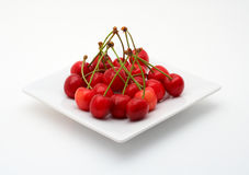 Cherries on the white plate Royalty Free Stock Images