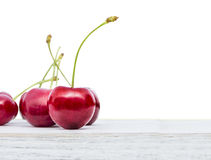 Cherries on white table , isolated on white background Royalty Free Stock Images