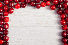 Cherries on white wooden table with copyspace available Royalty Free Stock Image