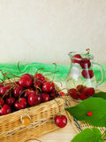 Cherries in a wicker basket Stock Images