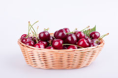 Cherries in wicker basket isolated on white Stock Photography