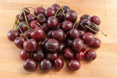 Cherries on the wood tabel. Fresh red cherries on the wood tabel Royalty Free Stock Images