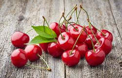 Cherries on a wooden background Stock Photography